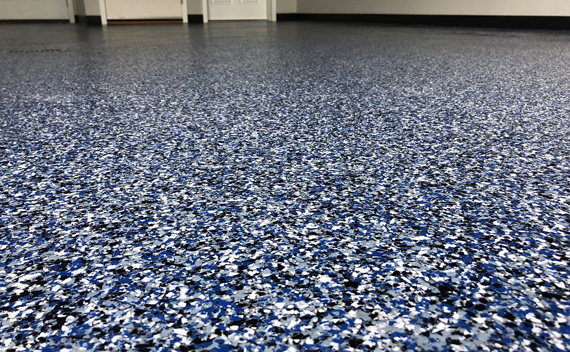 blue, white, and black specialty epoxy flooring